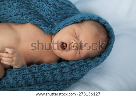Close up Cute White New Born Baby Lying in Prone on White Cotton Cloth with Open Mouth - stock photo