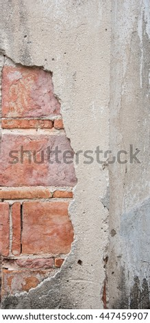 close-up damaged concrete pillar, cracked brick wall texture - stock photo