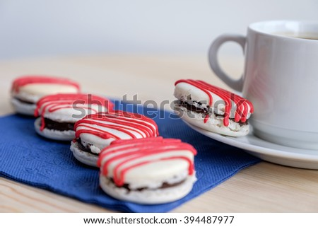 Close up decorated cookies on table with napkin and white cup   - stock photo