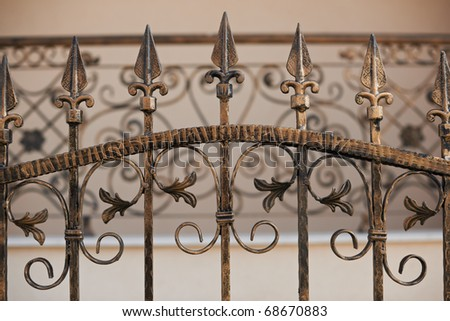 Close-up detail of a wrought iron fence - stock photo