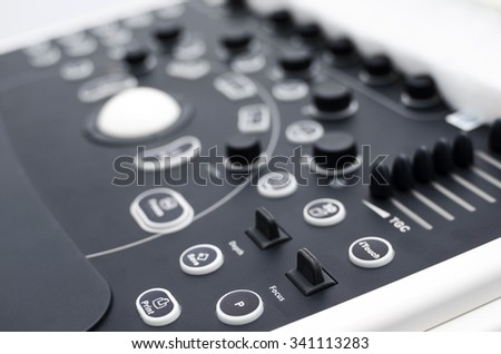Close up detail of an medical ultrasound machine keyboard. Shallow depth of field. - stock photo
