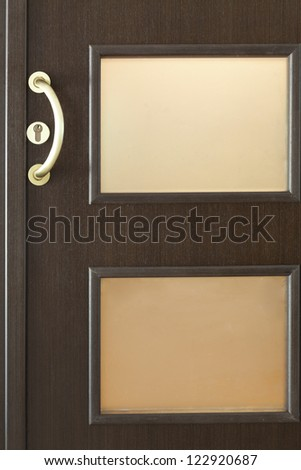 Close up detail of an new style wooden door - stock photo
