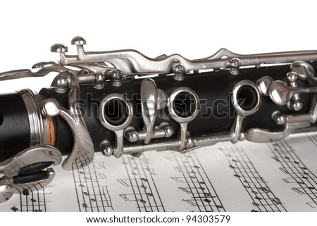 close up detail of clarinet and notebook with notes - stock photo