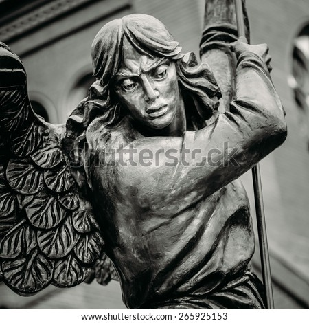 Close Up Detail Of Statue Of Archangel Michael With Outstretched Wings, Thrusting Spear Into Dragon Before Catholic Church Of St. Simon And St. Helena On Independence Square In Minsk, Belarus - stock photo