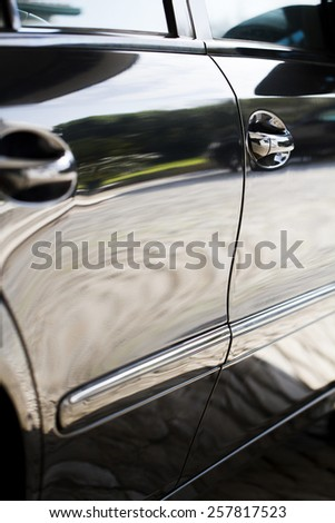 Close up detail of the door sides of a automobile. - stock photo