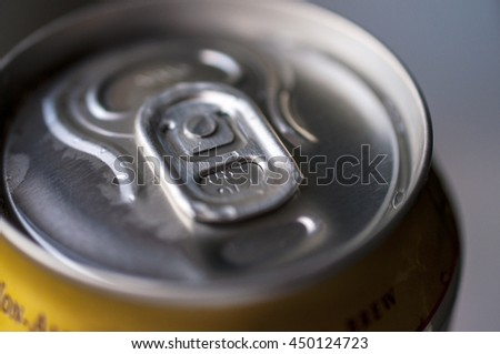 Close-up detail of the metal can with beverage - stock photo