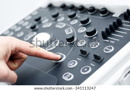 Close up detail of using a medical ultrasound machine keyboard. Shallow depth of field. - stock photo