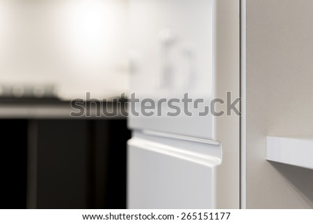 Close up detail of white kitchen cupboard - stock photo