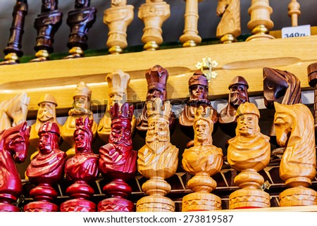 Close-up, detailed images of various chess pieces, queen, king, pawns on sale in the shop - stock photo