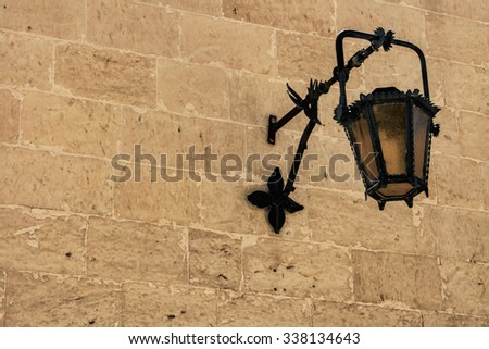Close-up details of a medieval street lamp in Malta. - stock photo