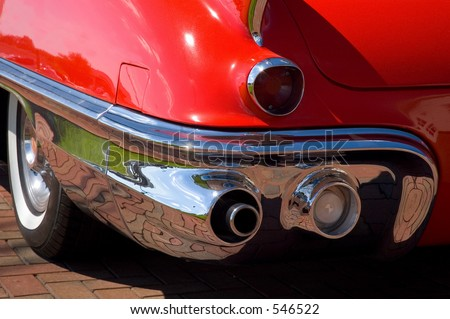 Close-up details of the rear taillight and fender of a classic American automobile. - stock photo