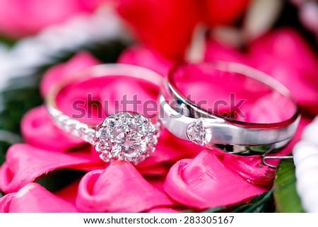 Close up diamond couple wedding rings - stock photo