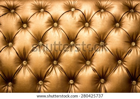 close up diamond on leather texture in gold concept - stock photo