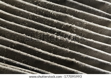 Close up dirty car air conditioner filter isolated on white - stock photo