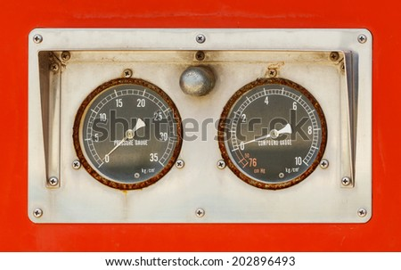 Close up dirty old and weathered pressure and compound gauges - stock photo