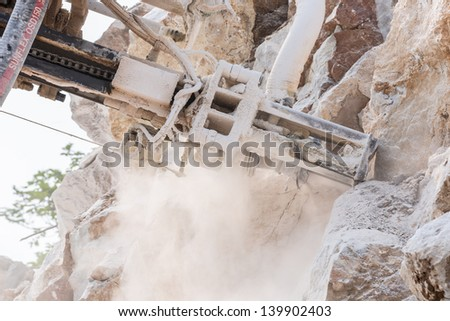 close up drilling ring drill the rock hole for demolition at mine site - stock photo