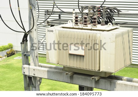 Close up Electric Transformer  on tower  - stock photo
