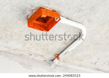Close up electrical distribution system installation on ceiling in new building - stock photo
