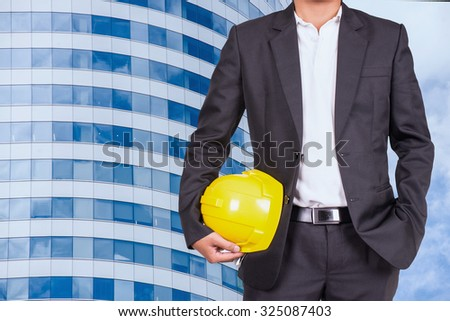 close up engineer in suit and windows building background  - stock photo