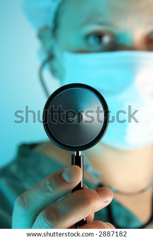 close-up examination by female doctor with stethoscope - stock photo