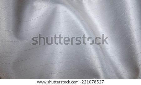 Close-up fabric silver textile texture to background - stock photo