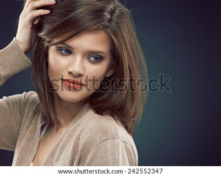 Close up face, beauty woman portrait. Young model posing against dark studio background. - stock photo