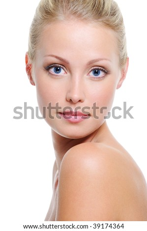 Close-up face of beautiful caucasian blonde woman with blue eyes over white - stock photo