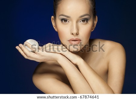 Close-up face of beautiful caucasian brunet woman with brown eyes. Studio shot - stock photo