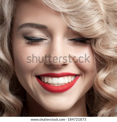 Close up face of beautiful Woman. Healthy Curly Hair. Gorgeous smile. - stock photo