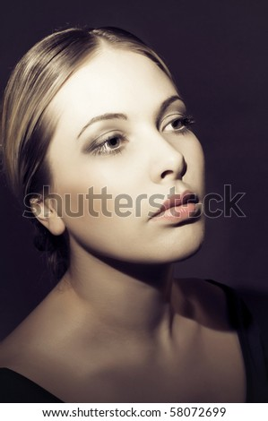 Close-up face of beautiful woman looking aside - stock photo