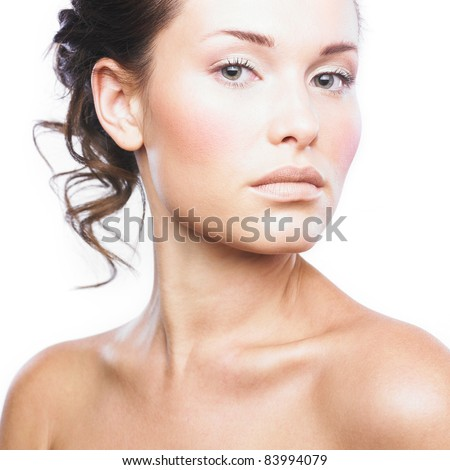 Close-up face of beautiful woman with clean fresh healthy skin. Isolated on white - stock photo