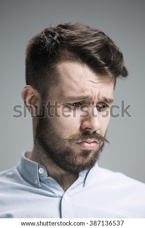 Close up face of  discouraged man  - stock photo