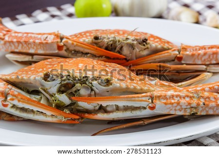 Close up face of streamed blue crabs ( sand crab ) - stock photo