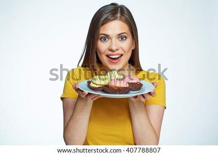 Close up face portrait of happy woman holding plate with macaron cake. French cake. Isolated portrait. - stock photo