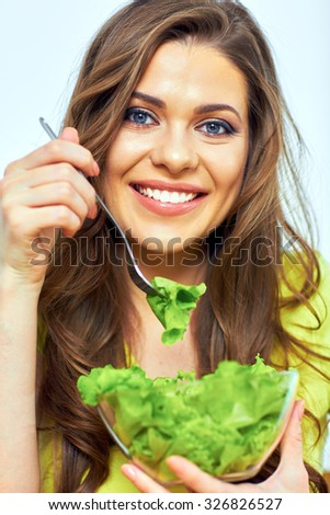 close up face portrait of woman for female healthy diet concept. woman eating salad. - stock photo