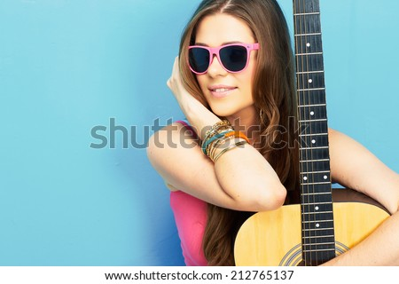 close up face portrait of young woman with guitar . modern style portrait of happy woman singer - stock photo