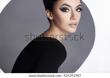 close-up fashion beauty portrait of young woman with make-up.beautiful model girl. Cosmetics  - stock photo