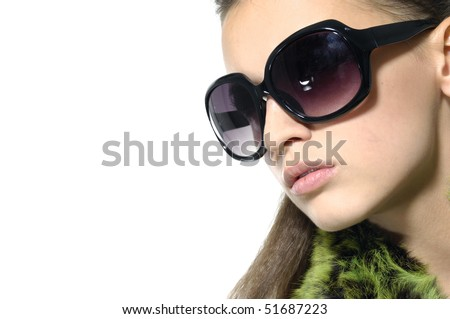 Close up fashion model wearing sunglasses - stock photo