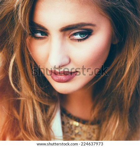 Close up fashion portrait of gorgeous smiling sensual pretty woman with perfect skin, bright natural make up, sexy full lips, and amazing fluffy curled hairs. Bright colors. - stock photo