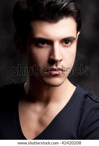 Close up Fashion Shot of a Young Man. A trendy European man dressed in contemporary cloth. He is now a professional model. - stock photo