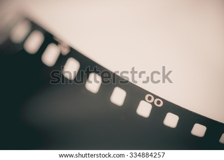 Close-up Film of a roll 35 mm photographic film; vintage tone style,soft focus - stock photo