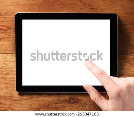 Close up Finger Touching Digital Tablet Device with Empty White Screen, Emphasizing Copy Space for Texts. - stock photo