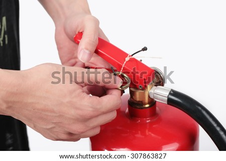 Close- up Fire extinguisher and pulling pin on red tank. - stock photo