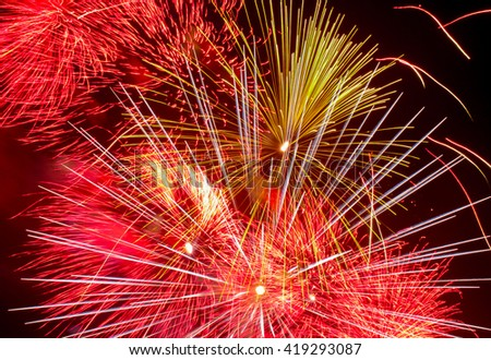 Close-up fireworks in the night sky - stock photo