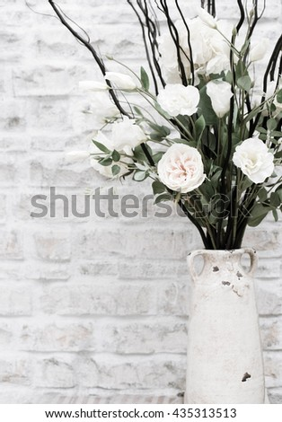 close up flower in jar for decorating on coffee&tea bar counter, toned image - stock photo