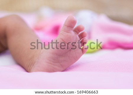 Close up foot of a little african american baby girl - Black people - stock photo