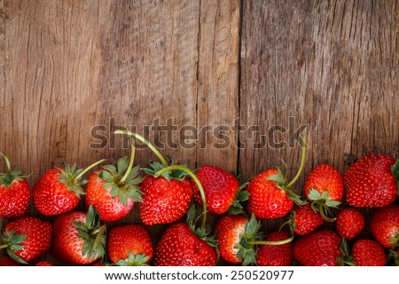 close up fresh strawberry on wooden background - stock photo