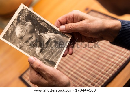 close up from a male hand with old photo - stock photo