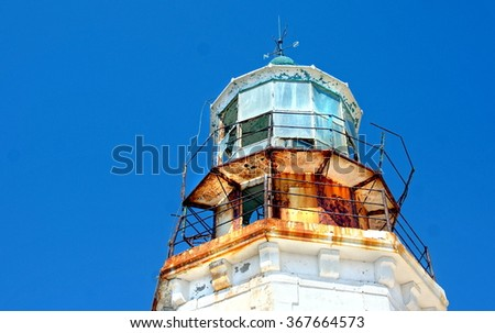close up from a old rusty lighthouse on the Cyclades, Greece - stock photo