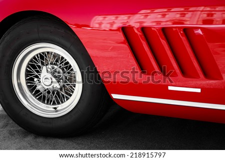 close up front left of a vintage red sports car - stock photo